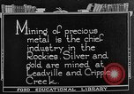 Image of gold panning Leadville Colorado USA, 1922, second 3 stock footage video 65675072890