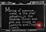 Image of gold panning Leadville Colorado USA, 1922, second 5 stock footage video 65675072890