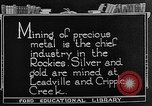 Image of gold panning Leadville Colorado USA, 1922, second 12 stock footage video 65675072890