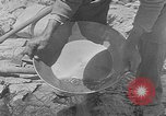 Image of gold panning Leadville Colorado USA, 1922, second 13 stock footage video 65675072890