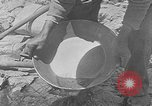 Image of gold panning Leadville Colorado USA, 1922, second 14 stock footage video 65675072890
