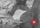 Image of gold panning Leadville Colorado USA, 1922, second 15 stock footage video 65675072890