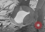 Image of gold panning Leadville Colorado USA, 1922, second 16 stock footage video 65675072890