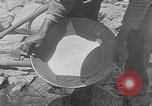 Image of gold panning Leadville Colorado USA, 1922, second 18 stock footage video 65675072890