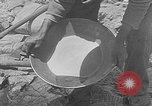 Image of gold panning Leadville Colorado USA, 1922, second 19 stock footage video 65675072890