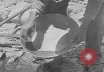Image of gold panning Leadville Colorado USA, 1922, second 20 stock footage video 65675072890