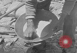 Image of gold panning Leadville Colorado USA, 1922, second 21 stock footage video 65675072890