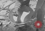 Image of gold panning Leadville Colorado USA, 1922, second 22 stock footage video 65675072890