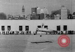 Image of Autogyro delivers mail to top of Post Office building United States USA, 1935, second 14 stock footage video 65675072921