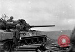 Image of US armor and infantry advancing in Ryukyu Campaign Pacific Theater, 1945, second 1 stock footage video 65675072977