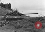 Image of US armor and infantry advancing in Ryukyu Campaign Pacific Theater, 1945, second 17 stock footage video 65675072977