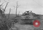 Image of US armor and infantry advancing in Ryukyu Campaign Pacific Theater, 1945, second 21 stock footage video 65675072977