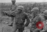 Image of US armor and infantry advancing in Ryukyu Campaign Pacific Theater, 1945, second 28 stock footage video 65675072977