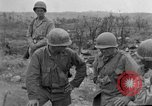 Image of US armor and infantry advancing in Ryukyu Campaign Pacific Theater, 1945, second 33 stock footage video 65675072977