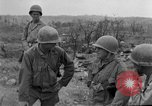 Image of US armor and infantry advancing in Ryukyu Campaign Pacific Theater, 1945, second 36 stock footage video 65675072977
