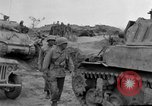 Image of US armor and infantry advancing in Ryukyu Campaign Pacific Theater, 1945, second 59 stock footage video 65675072977