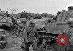 Image of US armor and infantry advancing in Ryukyu Campaign Pacific Theater, 1945, second 60 stock footage video 65675072977