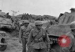 Image of US armor and infantry advancing in Ryukyu Campaign Pacific Theater, 1945, second 61 stock footage video 65675072977