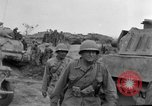 Image of US armor and infantry advancing in Ryukyu Campaign Pacific Theater, 1945, second 62 stock footage video 65675072977