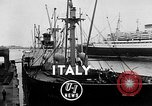 Image of arrival of coal Genoa Italy, 1947, second 2 stock footage video 65675073035