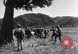 Image of Vietnamese soldiers Thakhet Laos, 1943, second 42 stock footage video 65675073079