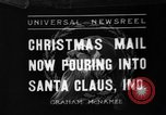 Image of children at workshop Santa Claus Indiana USA, 1936, second 1 stock footage video 65675073146