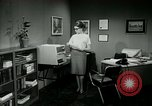 Image of woman worker arguing with boss United States USA, 1965, second 37 stock footage video 65675073400
