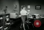 Image of woman worker arguing with boss United States USA, 1965, second 43 stock footage video 65675073400