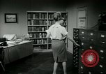 Image of woman worker arguing with boss United States USA, 1965, second 45 stock footage video 65675073400