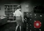 Image of woman worker arguing with boss United States USA, 1965, second 46 stock footage video 65675073400