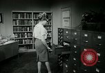 Image of woman worker arguing with boss United States USA, 1965, second 47 stock footage video 65675073400