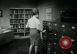 Image of woman worker arguing with boss United States USA, 1965, second 51 stock footage video 65675073400