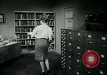 Image of woman worker arguing with boss United States USA, 1965, second 52 stock footage video 65675073400