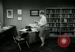 Image of woman worker arguing with boss United States USA, 1965, second 57 stock footage video 65675073400