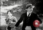 Image of Fictional movie from early in 20th Century United States USA, 1910, second 28 stock footage video 65675073424