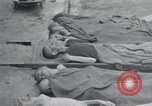 Image of emaciated corpses Germany, 1945, second 1 stock footage video 65675073860
