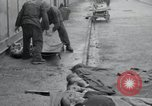 Image of emaciated corpses Germany, 1945, second 14 stock footage video 65675073860