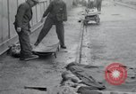 Image of emaciated corpses Germany, 1945, second 15 stock footage video 65675073860