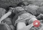 Image of dead bodies of inmates Germany, 1945, second 26 stock footage video 65675073862