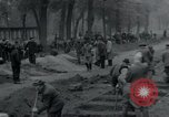 Image of German civilians bury Wobbelin victims Ludwigslust Germany, 1945, second 17 stock footage video 65675073877