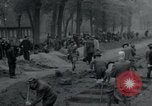 Image of German civilians bury Wobbelin victims Ludwigslust Germany, 1945, second 18 stock footage video 65675073877