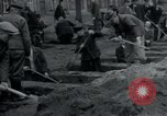 Image of German civilians bury Wobbelin victims Ludwigslust Germany, 1945, second 21 stock footage video 65675073877