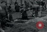 Image of German civilians bury Wobbelin victims Ludwigslust Germany, 1945, second 22 stock footage video 65675073877