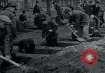 Image of German civilians bury Wobbelin victims Ludwigslust Germany, 1945, second 23 stock footage video 65675073877