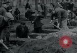 Image of German civilians bury Wobbelin victims Ludwigslust Germany, 1945, second 24 stock footage video 65675073877