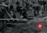 Image of German civilians bury Wobbelin victims Ludwigslust Germany, 1945, second 25 stock footage video 65675073877