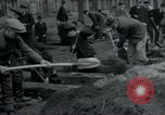 Image of German civilians bury Wobbelin victims Ludwigslust Germany, 1945, second 27 stock footage video 65675073877
