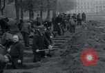 Image of German civilians bury Wobbelin victims Ludwigslust Germany, 1945, second 34 stock footage video 65675073877