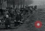 Image of German civilians bury Wobbelin victims Ludwigslust Germany, 1945, second 35 stock footage video 65675073877