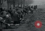 Image of German civilians bury Wobbelin victims Ludwigslust Germany, 1945, second 36 stock footage video 65675073877